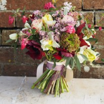 Daffodils, homegrown anemones, local foliage and hellebores included in this bunch.